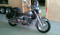 Motorrad kaufen Occasion HYOSUNG GV 250 Aquila (custom)